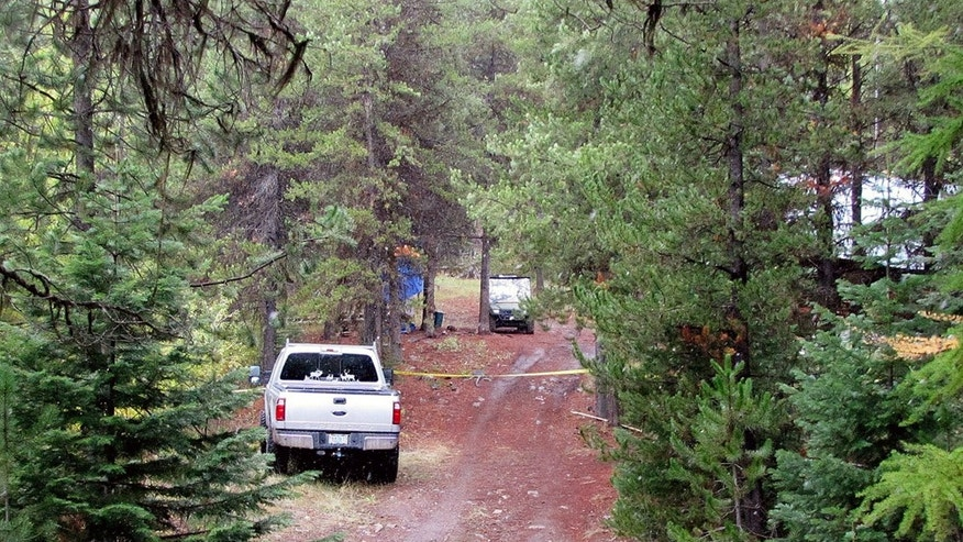 This undated photo provided by the Grant County Sheriff shows the site of a cabin near Granite, Ore., where a 14-year-old boy shot and killed two others and accidentally shot and wounded himself during a hunting trip on Wednesday, Oct. 2, 2013. One of the two men killed was the foster father of the 14-year-old boy identified as the shooter, authorities said Friday. (AP Photo/Grant County Sheriff)