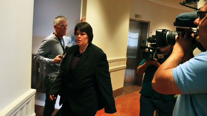 Lorinda Bailey enters a courtroom at the Denver Justice Center on the day of the first hearing in her felony child abuse case, in Denver, Tuesday, Oct. 8 2013. Bailey, 35, who is free on bond, and Wayne Sperling, 66, who is in custody, are charged with child abuse for allegedly starving their four sons, ages 2, 4, 5 and 6, and keeping them in an apartment full of feces and flies.All four have been placed in protective care and have undergone hospital exams that found that they could only communicate in grunts, were malnourished and were not toilet trained, according to an arrest affidavit. (AP Photo/Brennan Linsley)