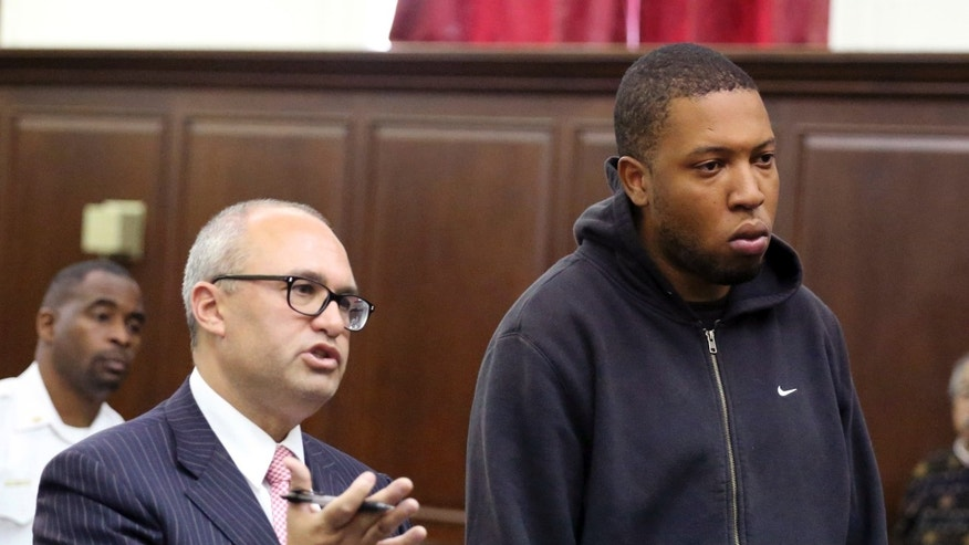 Craig Wright, right, stands in court with his attorney Mitchell Elman in New York, Tuesday, Oct. 8, 2013.  Wright, 29, of Brooklyn, was arrested on charges of gang assault, assault and unlawful imprisonment, police said, for his involvement with an encounter between a group of bikers and the driver of a sport utility vehicle on Sept. 29.   Dozens of bikers stopped the Range Rover SUV on a highway, attacked the vehicle, then chased the driver and pulled him from the car after he plowed over a motorcyclist while trying to escape, police said. The driver, Alexian Lien, needed stitches after being pummeled by the bikers.  (AP Photo/Jefferson Siegel, Pool)
