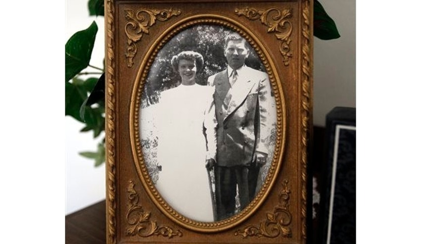 Oct. 7, 2013: A photograph of Jerry and Edith Dunn is displayed in their home in Spanish Fork, Utah. The couple lived 63 years together, died within hours of each other last week.
