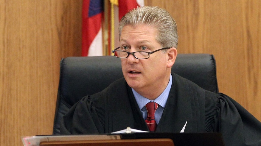 Judge Steven E. Gall, oversees the case of Bobby Thompson,  also known according to authorities as Harvard-trained attorney John Donald Cody, at the Cuyahoga County Justice Center on Tuesday,  Oct. 8, 2013 in Cleveland.   Thompson is charged with defrauding donors to a reputed charity, the United States Navy Veterans Association based in Tampa, Fla. He could face 40 years in prison if convicted.   (AP Photo/The Plain Dealer, Chuck Crow) MANDATORY CREDIT; NO SALES