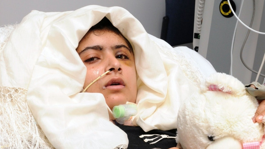 FILE - In this undated file photo provided by the University Hospitals Birmingham NHS Foundation Trust on Friday, Oct. 19, 2012, then 15-year old Pakistani shooting victim Malala Yousufzai lies on a bad as she recovers in Queen Elizabeth Hospital in Birmingham, England. European lawmakers have awarded their top human rights prize to Pakistani schoolgirl Malala Yousafzai, who survived a Taliban assassination attempt last year. The European Parliament announced Thursday, Oct, 10, 2013, that 16-year-old Malala won the 50,000 euro ($65,000) Sakharov Award. (AP Photo/University Hospitals Birmingham NHS Foundation Trust, File)