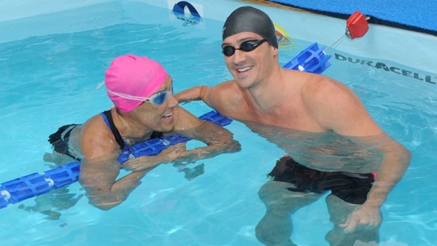 "Eleven-time Olympic medalist Ryan Lochte swims with Diana Nyad during her 48-hour continuous ""Swim for Relief"" to support Hurricane Sandy recovery efforts in New York's Herald Square."