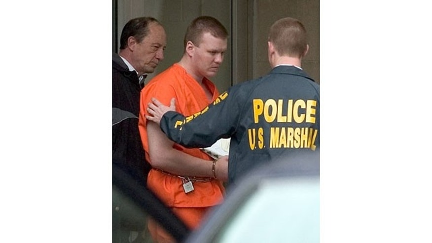 FILE - In a Tuesday, April 12, 2005 file photo, Chadrick Fulks is escorted by U.S. Marshals out of the federal courthouse in Huntington, W.Va., following his arraignment on charges if carjacking resulting in the death of Marshall University student Samantha Burns, felon in possession of a firearm, possession of stolen firearms and interstate transportation of a stolen motor vehicle. (AP Photo)