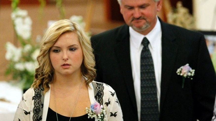 FILE 2013: Kidnap victim Hannah Anderson attends a memorial service for her mother and brother in Santee, California.