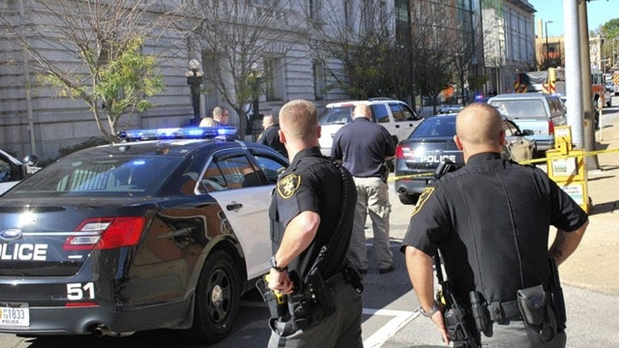 October 9, 2013: Local law enforcement officers secure an area in front of the Federal Buildng in Wheeling, WVa. Wedneday  following a shooting outside the courthouse. (AP Photo)