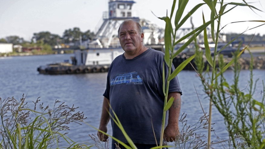 In this Wednesday, Oct. 9, 2013 photo, Calvin Parker, Jr., stands in the area where he and fellow Mississippian Charles Hickson were allegedly abducted by aliens on Oct. 11,1973, on the banks of the Pascagoula River in Pascagoula Miss. The incident made headlines, sparked UFO sightings nationwide and became one of the most widely examined cases on record. (AP Photo/Gerald Herbert)