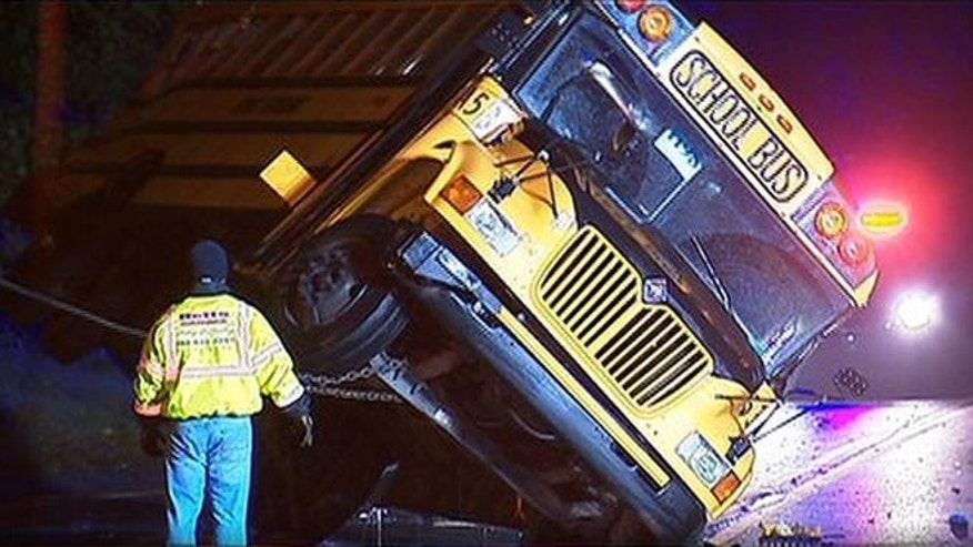 A school bus carrying students from the University of Delaware collided with a tractor-trailer Thursday night, injuring 9.