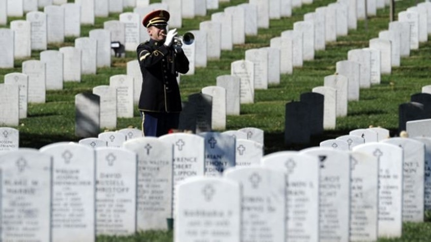 FILE: A bugler plays 'Taps' during the 2009 funeral for Army Spc. Stephen Mace at Arlington Cemetery in Arlington, Va. Air Force Lt. Col. Robert E. Pietsch, Maj. Louis F. Guillermin, and Army Air Force 1st Lt. Robert G. Fenstermacher will be buried at Arlington.