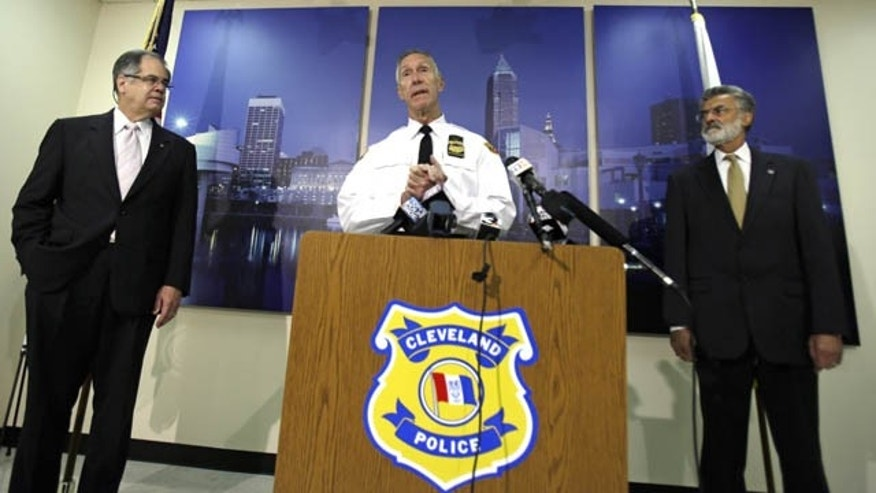 October 15, 2013: Cleveland Police Chief Michael McGrath, center, announces the results of disciplinary hearings for officers involved in a deadly chase. (AP Photo)