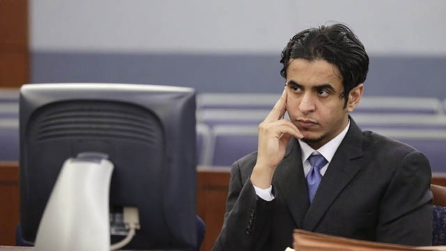October 11, 2013: Defendant Mazen Alotaibi, listens to comments by Judge Stefany Miley during the jury selection process for his trial Friday at Justice Court in Las Vegas. The 24-year-old Saudi Arabian air force sergeant is charged with raping a 13-year-old boy at a Las Vegas Strip hotel. (AP Photo/Julie Jacobson)