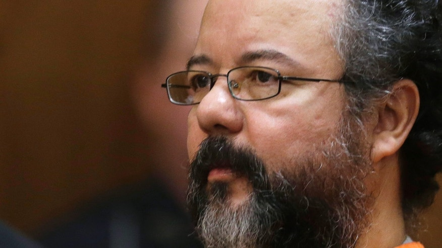FILE - This Aug. 1, 2013 file photo shows Ariel Castro in the courtroom during the sentencing phase in Cleveland. A report from prison guards released Tuesday, Oct. 15, 2013 by the Ohio Department of Rehabilitation and Correction provides more details about the death of Cleveland kidnapper Ariel Castro, but they offer few additional clues about whether he meant to kill himself or was strangled accidentally while performing a sex act.   (AP Photo/Tony Dejak, File)