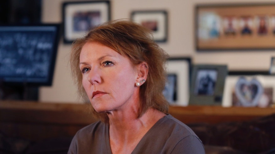 Melinda Coleman listens to a question during an interview in her home in Albany, Mo., Wednesday, Oct. 16, 2013. Coleman says justice was denied when charges were dropped against the boys that her 14-year-old daughter said sexually assaulted her and a 13-year-old friend. (AP Photo/Orlin Wagner)