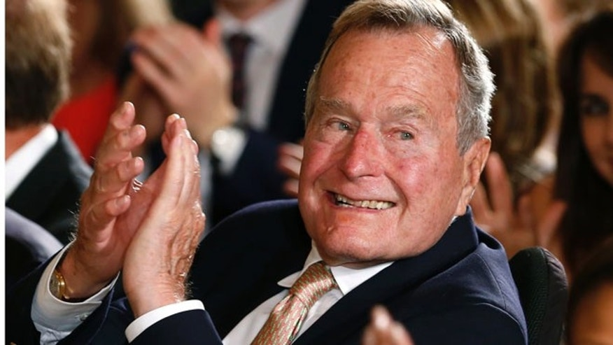 July 15, 2013: Former President George H.W. Bush applauds during an event to honor the winner of the 5,000th Daily Point of Light Award at the White House in Washington.