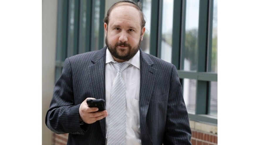 May 9, 2013: In this file photo, Yosef Kolko, 39, walks near the Ocean County Courthouse in Toms River, N.J., during a break in his trial on sexual assault charges.