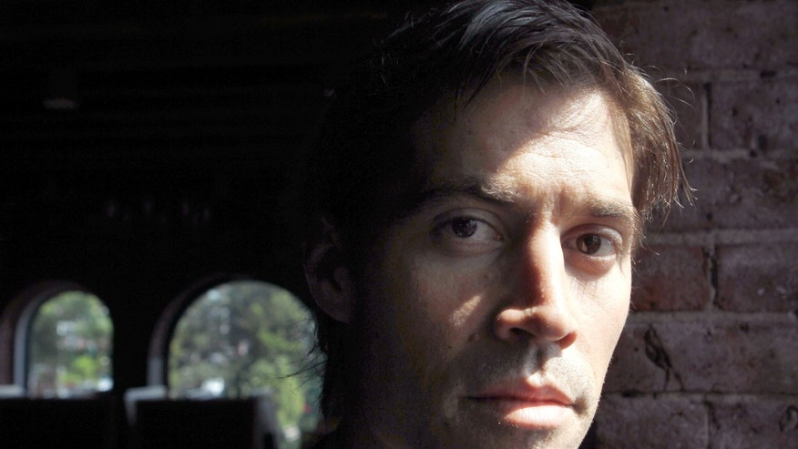 May 27, 2011:  In this file photo, American journalist James Foley, of Rochester, N.H., who was last seen on Nov. 22 2012 in northwest Syria, poses for a photo in Boston.