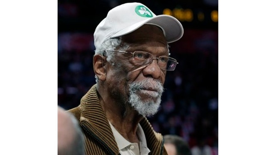 FILE: Feb. 16, 2013: Former Boston Celtis' Bill Russell watches the NBA All-Star Saturday Night basketball competition in Houston. Russell was arrested Oct. 16, 2013 as he attempted to go through security.