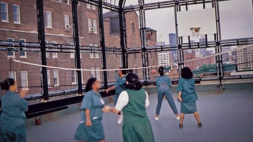 In this undated photo from 2001 provided by the New York State Department of Corrections and Community Supervision (DOCCS), female inmates play volleyball on the rooftop playground of the Bayview Correctional Facility, minimum security women's prison in the Chelsea section of New York.
