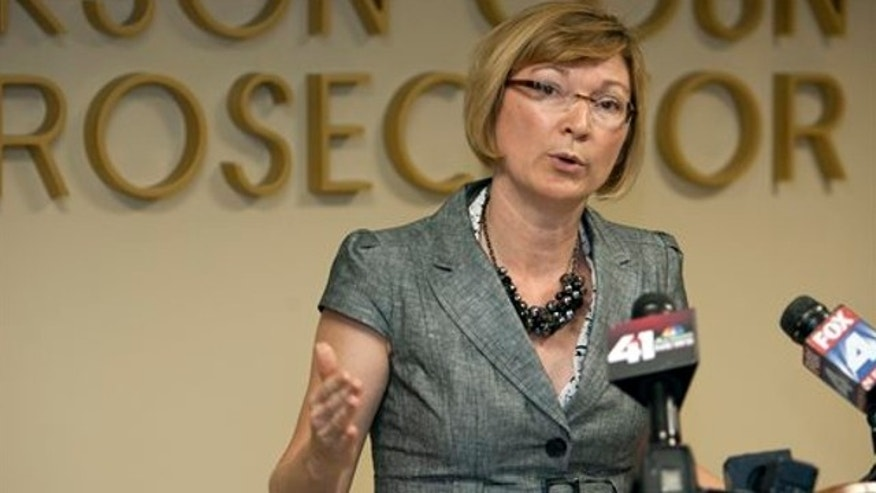 FILE: Aug. 3, 2012: Jackson County Prosecutor Jean Peters Baker addresses the media during a news conference, in Kansas City, Mo.