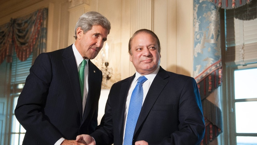 Secretary of State John Kerry meets with Pakistan Prime Minister Nawaz Sharif at the State Department in Washington, Sunday, Oct. 20, 2013. (AP Photo/Cliff Owen)