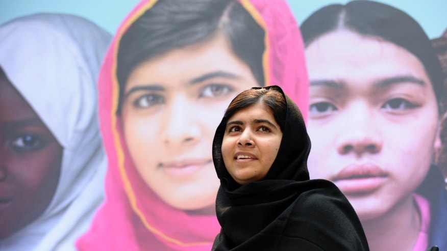"FILE - In this Oct. 11, 2013, file photo Malala Yousafzai, the 16-year-old girl from Pakistan, who was shot in the head by the Taliban last October for advocating education for girls, speaks on occasion of the International Day of the Girl at the World Bank in Washington. Malala has inspired the development of school curriculum encouraging advocacy. George Washington University announced Monday, Oct. 14, that faculty members are creating curriculum tools to accompany her book, ""I Am Malala."" Several faculty members will pilot the curriculum early next year for both college and high school instruction. (AP Photo/Susan Walsh)"