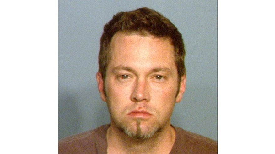 This April 2012 jail booking photo provided by the Las Vegas Metropolitan Police is of Benjamin Paul Frazier.