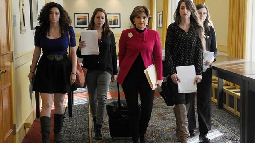 Oct. 21: Attorney Gloria Allred, center, walks with University of Connecticut students Rose Richi, left, Erica Daniels, Carolyn Luby, second from right, and Kylie Angell, right, to a news conference in Hartford.