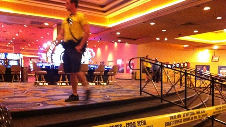 Oct. 21, 2013: Security personnel cordon off the scene of an early morning shooting at Bally's Hotel-Casino on the Las Vegas Strip.