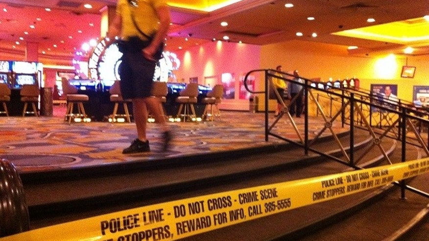 Security personnel cordon off the scene of an early morning shooting at Bally's Hotel-Casino on the Las Vegas Strip on Monday, Oct. 21, 2013. Las Vegas police said a man opened fire about 5:45 a.m. in the casino at 3645 Las Vegas Boulevard South, near Flamingo Road, after he was refused entrance to Drai's After Hours nightclub. The shooting left one dead and two others injured. (AP Photo/Las Vegas Review-Journal, Mike Blasky)  LOCAL TV OUT; LOCAL INTERNET OUT; LAS VEGAS SUN OUT