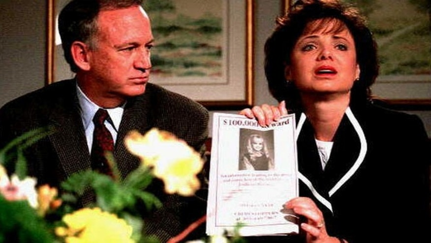 FILE 1997: John and Patsy Ramsey hold reward poster regarding death of JonBenet.