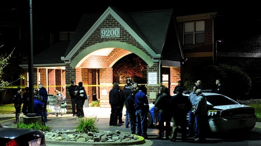 Oct. 20, 2013: Police swarm the scene after two women were gunned down around 5:45 p.m. at the Pablo Davis Elder Living Center in Detroit, Mich.