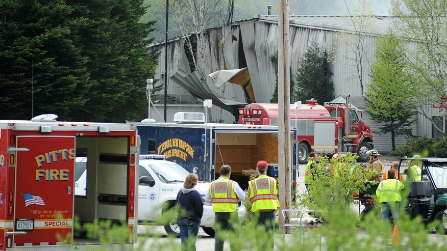FILE - In this May 14, 2010 file photo, rescue vehicles stand outside a gunpowder plant after an explosion at the plant killed two people in Colebrook, N.H. The owner of the Black Mag plant, Craig Sanborn, 64, of Maidstone, Vt., was convicted of negligent homicide on Wednesday, Oct. 23, 2013.  (AP Photo/Steve Legge, File)