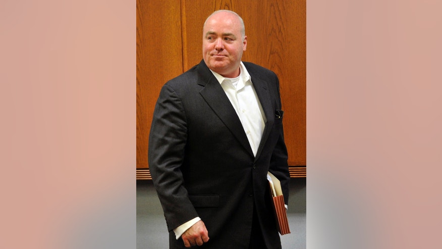 FILE - In this April 30, 2013 file photo,  Michael Skakel leaves the courtroom after the conclusion of  trial regarding his legal representation at State Superior Court in Vernon, Conn. A Connecticut judge on Wednesday, Oct. 23, 2013, granted a new trial for Skakel, ruling his attorney failed to adequately represent him when he was convicted in 2002 of killing his neighbor in 1975. (AP Photo/The Greenwich Time, Jason Rearick, Pool, File)