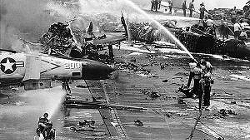 On July 29, 1967, while in the Gulf of Tonkin during the Vietnam War, stray voltage triggered a rocket to launch from an A-4 Phantom on the flight deck, ultimately striking an armed A-4 Skyhawk piloted by then-Lt. Cmdr. John S. McCain III. A chain reaction of fires and explosions ensued, causing a daylong fire aboard the ship's deck, which was fully packed with planes. In all, 134 men were killed, more than 300 others were injured and 21 aircraft were damaged.  (U.S. Navy)