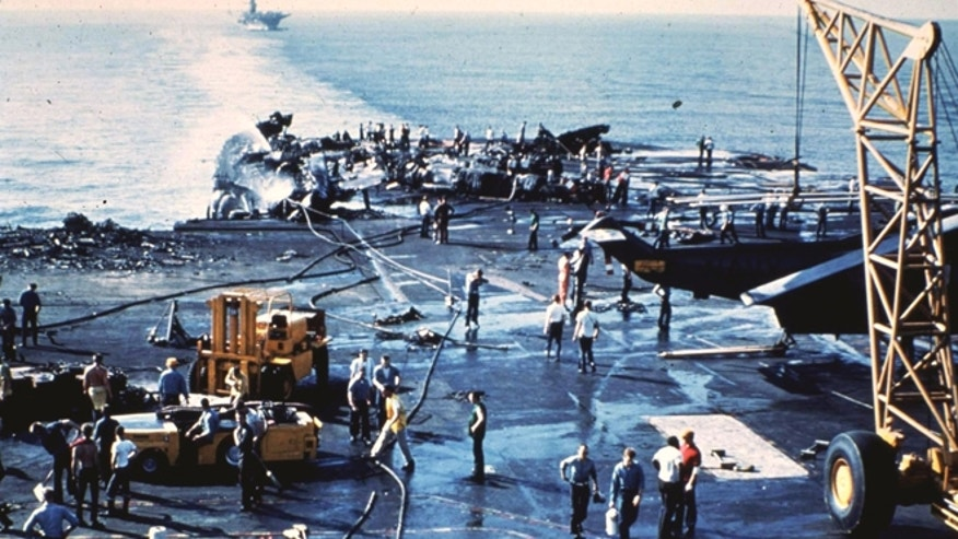 The incident prompted changes within the Navy to damage control and disaster response training, as most of the sailors who were trained as firefighters were reportedly killed during the initial blast, forcing the remaining crew to improvise its rescue efforts. (Courtesy: Ken Killmeyer)