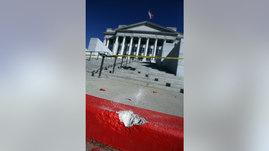 Francisco Kjolseth  |  The Salt Lake Tribune The curb is chipped where a man drove up the steps in the background to the west entrance to the Utah State Capitol in Salt Lake City Tuesday Oct. 22, 2013.  Utah state troopers used a stun gun to arrest the man who drove the pickup truck.  (AP Photo/The Salt Lake Tribune, Francisco Kjolseth)  DESERET NEWS OUT; LOCAL TV OUT; MAGS OUT
