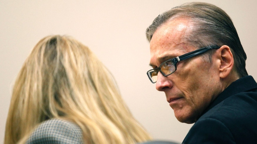 Martin MacNeill, right, speaks with his attorney Susanne Gustin during his trial in Judge Derek Pullan's 4th District Court in Provo, Utah, Tuesday, Oct. 22, 2013. MacNeill, a former Utah doctor, is charged in his wife's death. Investigators have said MacNeill helped his wife, Michele, into a bathtub where she may have drowned. No cause of death was ever established. Defense lawyers maintain Michele MacNeill died of a heart attack while filling a tub. (AP Photo/The Daily Herald, Mark Johnston)
