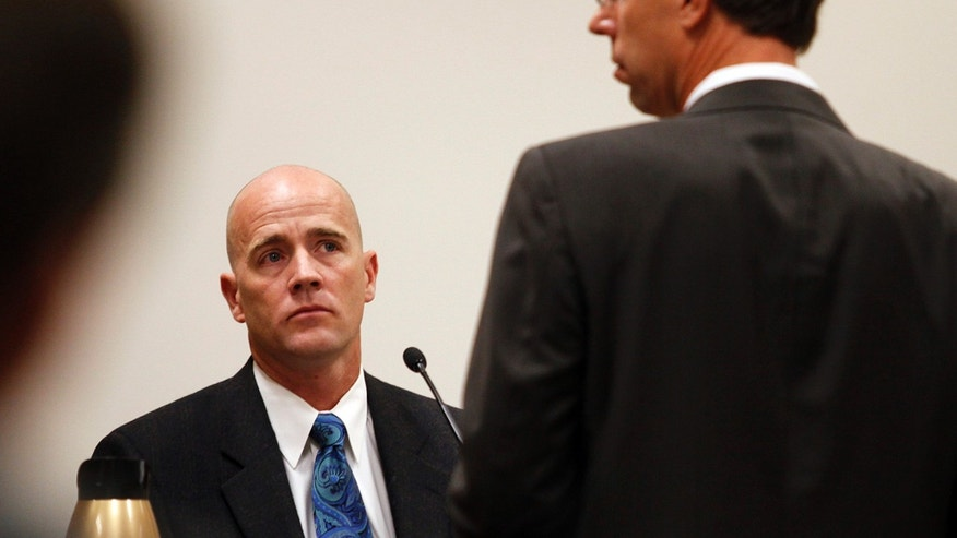 Marc Sanderson, chief of the Pleasant Grove Fire Department, testifies during the trial of Martin MacNeill in Judge Derek Pullan's 4th District Court in Provo, Utah, Tuesday, Oct. 22, 2013. MacNeill, a former Utah doctor, is charged in his wife's death. Investigators have said MacNeill helped his wife, Michele, into a bathtub where she may have drowned. No cause of death was ever established. Defense lawyers maintain Michele MacNeill died of a heart attack while filling a tub. (AP Photo/The Daily Herald, Mark Johnston)