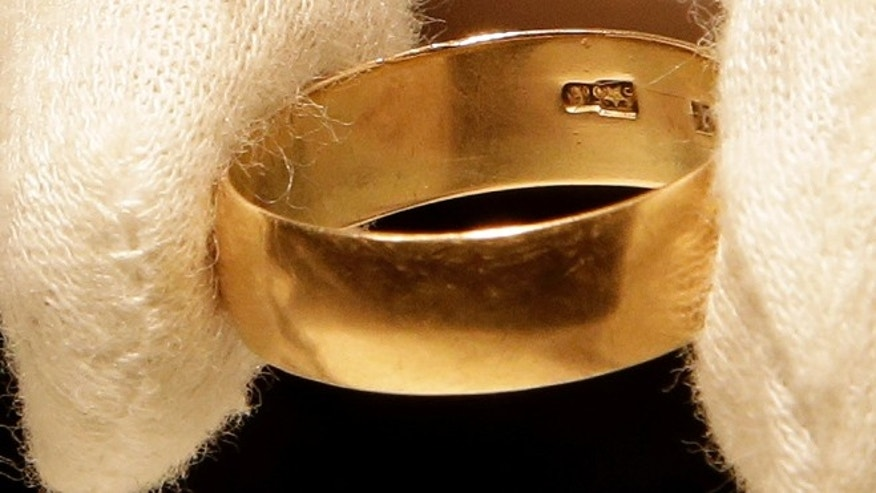 "Oct. 22, 2013: Lee Harvey Oswald's wedding ring, which he left at his wife's, Marina Oswald, bedside the morning of the assassination of President John Fitzgerald Kennedy, is part of a themed JFK memorabilia auction ""Camelot: Fifty Years After Dallas"" at the Omni Parker House hotel in Boston. Engraved on the inside of the ring is a Star of Russia. (AP/Stephan Savoia)"