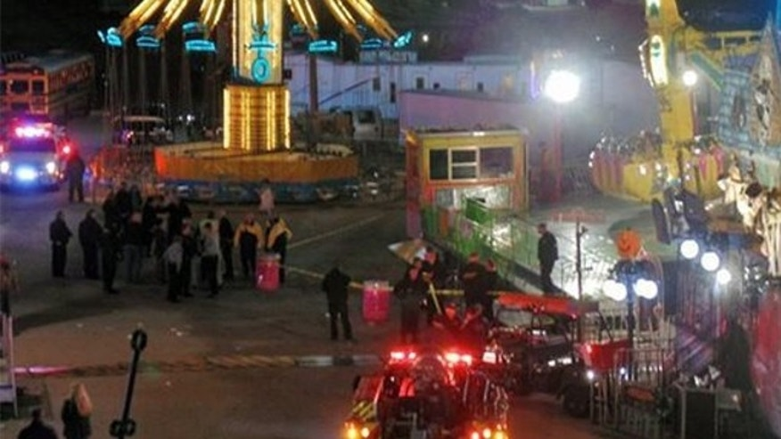 Oct. 24, 2013: In this photo provided by WNCN, emergency crews respond to the scene where a ride malfunctioned at the North Carolina State Fair in Raleigh, N.C.