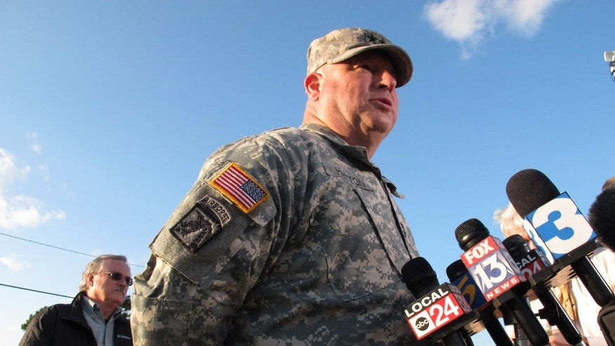 Oct. 24, 2013: Maj. Gen. Max Haston, right, Adjutant General of the Tennessee National Guard, speaks at a news conference near a Guard armory where two Guard members were shot on Thursday in Millington, Tenn. At left is Tennessee National Guard spokesman Randy Harris. (AP/Adrian Sainz)