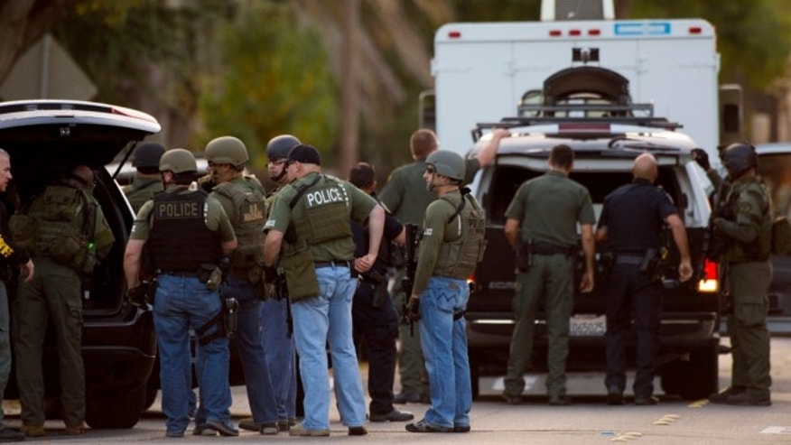 Oct. 25, 2013: Police converge on a house where Sammy Duran is suspected to be residing on in Roseville, Calif. Duran is a suspect in the shooting of several law enforcement officers that occurred Friday.