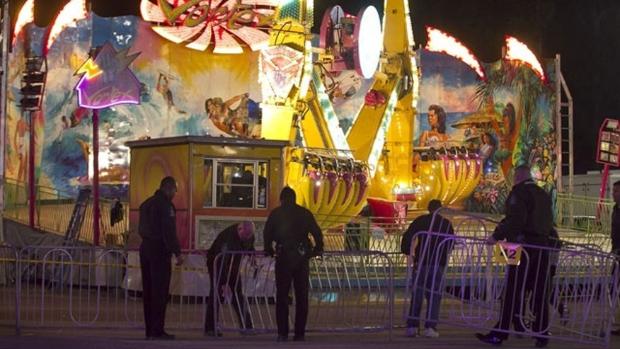 October 24, 2013: Fairgrounds Police secure a barricade around the Vortex after an accident closed the ride just after 9 p.m. at the N.C. State Fair in Raleigh, N.C. (AP Photo)