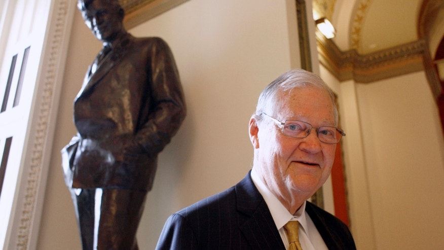 FILE - In this Nov. 16, 2010 file photo, Rep. Ike Skelton, D-Mo., who lost his seat earlier that month, poses for a photograph in front of the Will Rogers Statue, on Capitol Hill in Washington. Skelton, who built a reputation as a military expert and social conservative during 34 years representing western and central Missouri in the U.S. House, died Monday, Oct. 28, 2013 in Virginia. He was 81. (AP Photo/Harry Hamburg, File)