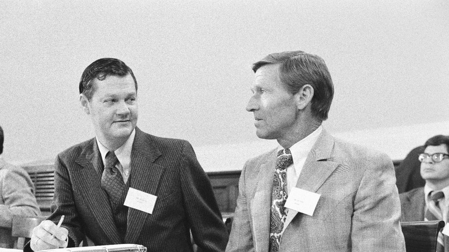 FILE - In this Dec. 3, 1976 file photo, then newly elected members of the House of Representatives, Ike Skelton, D-Mo., left, and Bob Stump, D-Ariz., attended an orientation meeting on Capitol Hill in Washington. Skelton, who built a reputation as a military expert and social conservative during 34 years representing western and central Missouri in the U.S. House, died Monday, Oct. 28, 2013 in Virginia. He was 81. (AP Photo/Harvey Georges, File)