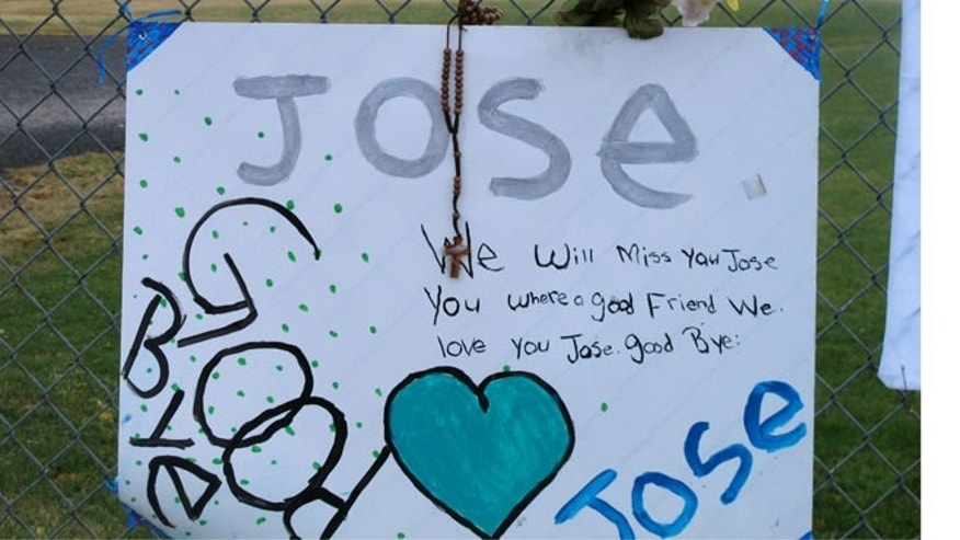 Oct. 28, 2013: A remembrance of the shooter, Jose Reyes, 12, hangs on a fence as students return to Sparks Middle School in Sparks, Nev.