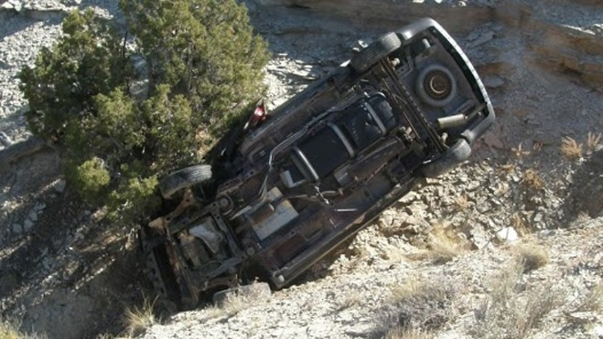 Oct. 18, 2013: The minivan belonging to David Welch, 54, of Manhattan, Kan., rests on its side in a desolate part of eastern Utah.