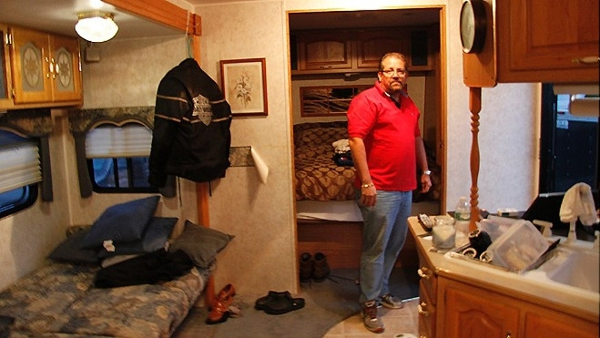 Bernie Neihaus has been forced to live in this rented trailer on his property in Brick Township while he deals with red tape in repairing his home.