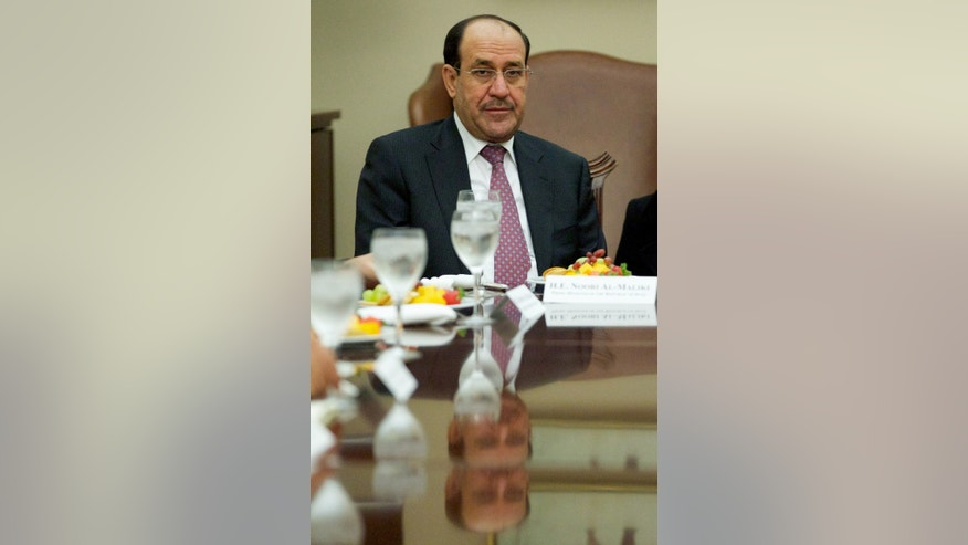 Iraq's Prime Minister Nouri al-Maliki listens during a meeting with House Foreign Affairs Committee Chairman Rep. Ed Royce, R-Calif., and the committee's ranking Democrat Rep. Eliot Engel, D-N.Y., Wednesday, Oct. 30, 2013, on Capitol Hill in Washington.  (AP Photo/Molly Riley)
