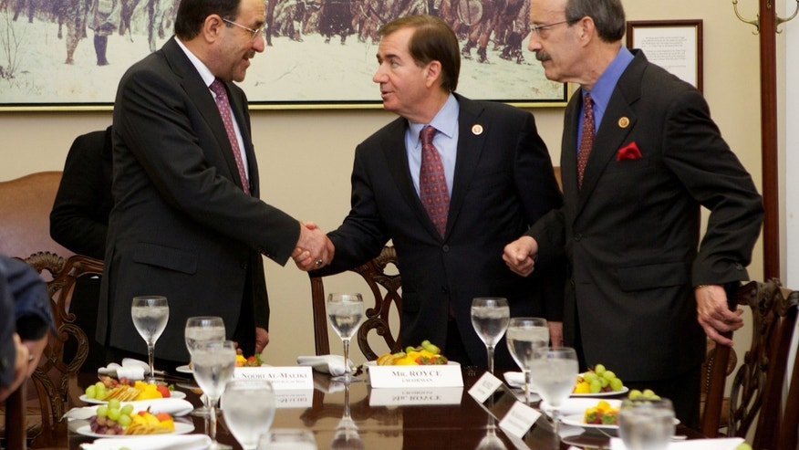 Iraq's Prime Minister Nouri al-Maliki, left, is greeted by House Foreign Affairs Committee Chairman Rep. Ed Royce, R-Calif., center, and the committee's ranking Democrat Rep. Eliot Engel, D-N.Y., on Capitol Hill in Washington, Wednesday, Oct. 30, 2013, during a luncheon meeting.  (AP Photo/Molly Riley)